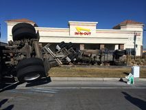 Semi Trailer carrying milk rolled over into In-n-Out restaurant property. Royalty Free Stock Images