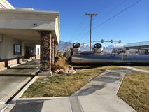 Semi Trailer carrying milk rolled over into In-n-Out restaurant property. Stock Photo