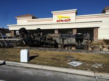 Semi Trailer carrying milk rolled over into In-n-Out restaurant property. Royalty Free Stock Photos