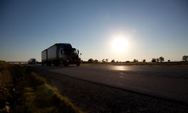 Semi-trailer drving down the highway Stock Photo
