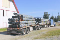 Semi Trailer Hauling Pipes or Poles Royalty Free Stock Photography