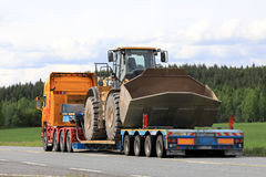 Semi Trailer Hauls Large Cat Wheel Loader Royalty Free Stock Images