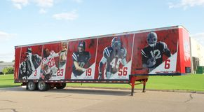 Semi-trailer with Ole Miss Football players on it. Stock Image