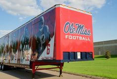 Semi-trailer with Ole Miss Football on it. Royalty Free Stock Photos