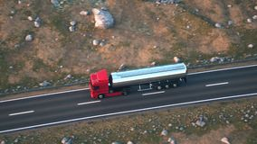 Semi-trailer tank truck driving along a desert road. Aerial shot of a tank truck driving on a highway into the sunset. Realistic high quality 3d animation stock video footage