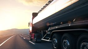 Semi-trailer tank truck driving along a desert road into the sunset. The camera follows a tank truck driving along a desert highway into the sunset. Low angle stock footage