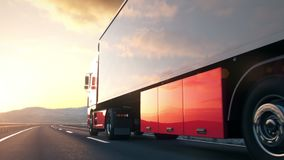 Semi-trailer truck driving along a desert road. A semi truck passes the camera driving on a highway into the sunset, low angle rear view camera. Realistic high stock footage