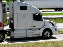 Semi truck. Big semi trailer trucks driving on highway Royalty Free Stock Images