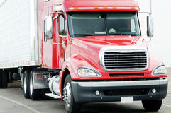 Semi-truck. Large clean and shiny red semi-truck hauling freight Stock Photography