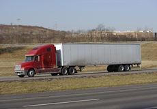 Semi Truck. Tractor Trailer on the Highway Stock Images