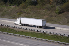 Semi Truck. White Tractor Trailer on the Highway Stock Image