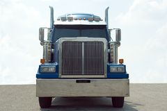 Semi Truck. Front view of a blue 18 wheel semi truck with a blue sky background Stock Photo