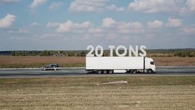 Semi-truck with cargo trailer on highway with indication of load capacity