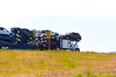 Semi_Truck_classic_car_carrier_with_cars_on_the_trailer Royalty Free Stock Images