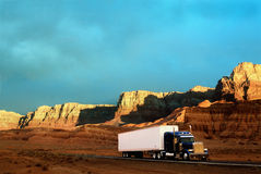 Semi-truck on desert highway Stock Images