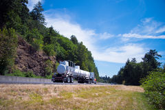 Semi truck drive tank trailer for chemical materials on road Stock Image
