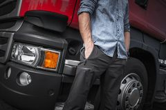 Semi Truck Driver Job. Caucasian Trucker in Front of His Truck. Closeup Photo Stock Photo