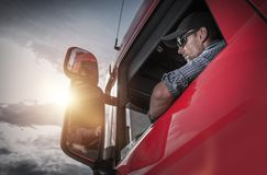 Semi Truck Driver. Red Semi Truck. Caucasian Truck Driver Preparing For the Next Destination Royalty Free Stock Photography