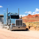 Semi-truck driving across the desert Royalty Free Stock Photography