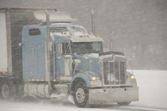 Semi-Truck driving in a blizzard Stock Photography