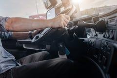 Semi Truck Driving Job. Caucasian Men Behind Semi Truck Steering Wheel. Cabin Interior. Transportation and Spedition Industry Royalty Free Stock Photo