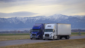 SEMI TRUCK DRIVING ON MOUNTAIN HIGHWAY Royalty Free Stock Image
