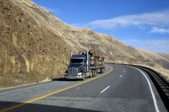 SEMI TRUCK DRIVING ON MOUNTAIN HIGHWAY Stock Photography
