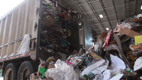 A Semi Truck Dropping Trash at the Recycling Center (1 of 7). Trash being delivered to be recycled stock video footage