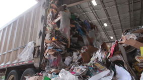 A Semi Truck Dropping Trash at the Recycling Center (3 of 7). Trash being delivered to be recycled stock footage
