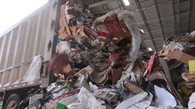A Semi Truck Dropping Trash at the Recycling Center (5 of 7). Trash being delivered to be recycled stock video footage