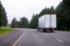 Semi truck with dry van semi truck moving on scenic curvy highwa Stock Photo