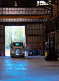 Semi truck entering old antic building warehouse unloading cargo Stock Image