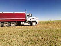 Semi truck in field. stock image