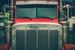 Semi Truck Grill Closeup. Red Semi Truck Chrome Grill Closeup. Heavy Duty Transportation Theme royalty free stock photo