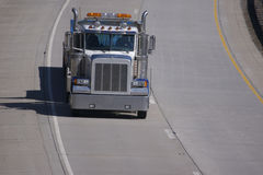 Semi Truck on the Highway. Semi Tractor Trailer Truck  on the Highway with Copy Space Stock Image