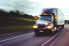 Semi truck on highway concept with motion blur