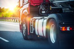 Semi Truck on a Highway. Red Semi Truck Speeding on a Highway. Tractor Closeup. Transportation and Logistics Theme royalty free stock photos