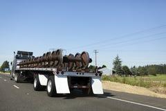 Semi Truck Railroad Freight. Semi truck transporting train wheels Stock Photo