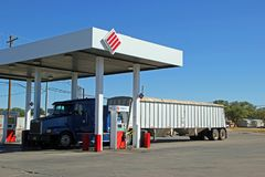 Semi truck refueling at Stripes gas station in Fort Stockton. A semi truck refueling at a Stripes gas station in Fort Stockton, Texas, on October stock photo