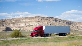 Semi-truck on the road in the desert. A semi-truck on the road in the desert Royalty Free Stock Photography