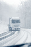 Semi truck on a snowy mountain road Royalty Free Stock Image