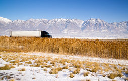 Semi Truck Speeding down Utah Highway Winter Wasatch Mountains Stock Photos