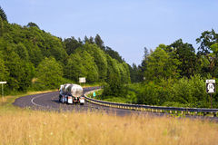 Semi Truck with tanks on scenic winding highway road Royalty Free Stock Image