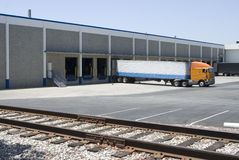 Semi truck / Trailer. Near Railroad Tracks and Warehouse Stock Image