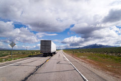Semi truck trailer on flat plateau road of Arizona Royalty Free Stock Photos
