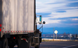 Semi truck trailer mirrors on road with cloudy sky Royalty Free Stock Photo