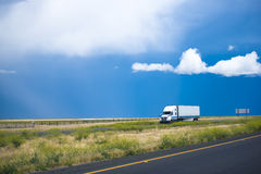 Semi truck trailer moving road with awesome landscape in Califor Stock Images