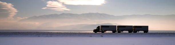 Semi Truck Travels Highway Over Salt Flats Frieght Transport Stock Photo