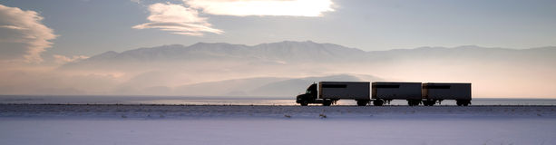 Semi Truck Travels Highway Over Salt Flats Frieght Transport Stock Photo
