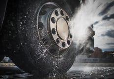 Semi Truck Wheels Washing. Semi Truck Wheels High Pressured Water Washing Closeup Photo Stock Image